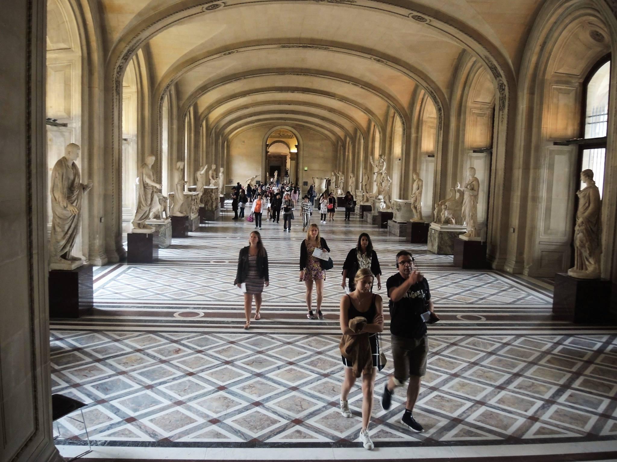 Walking the halls at Musée du Louvre