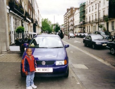 My nephew R.J. in front of my third or fourth car, June 2001.