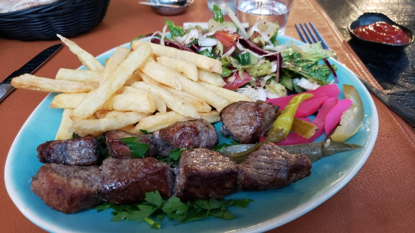 Kastaletta, Grilled lamb with fries and a salad at Le Prince Restaurant Lounge.